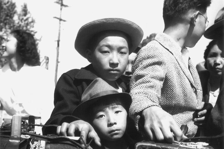 "Dorothea Lange, ""Young evacuees of Japanese ancestry wait their turn for baggage inspection, Turlock, CA,"" 1942 [detail]. Gelatin silver print (printed later). Private collection; courtesy of Photographic Traveling Exhibitions."
