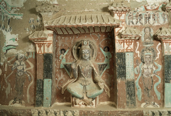 """Cave 275, statue of Maitreya, from """"Caves of Dunhuang"""" at the Getty Center"""