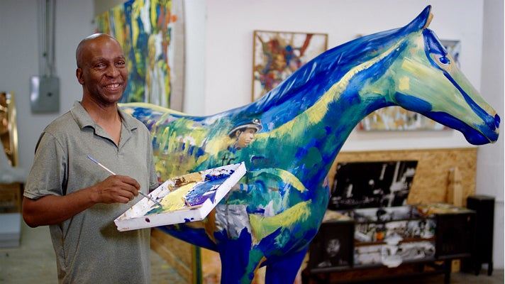 "Michael Massenburg paints ""Racing With Time"""