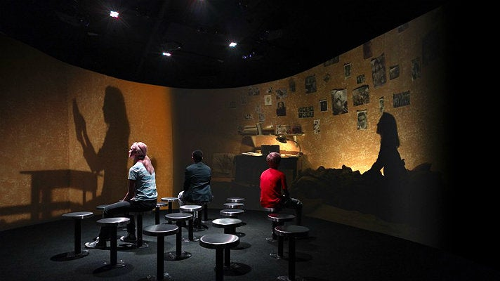 Visitors experience the Secret Annex at the Museum of Tolerance