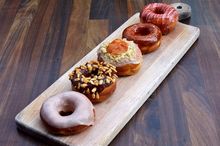 Flight of brioche donuts at The Strand House